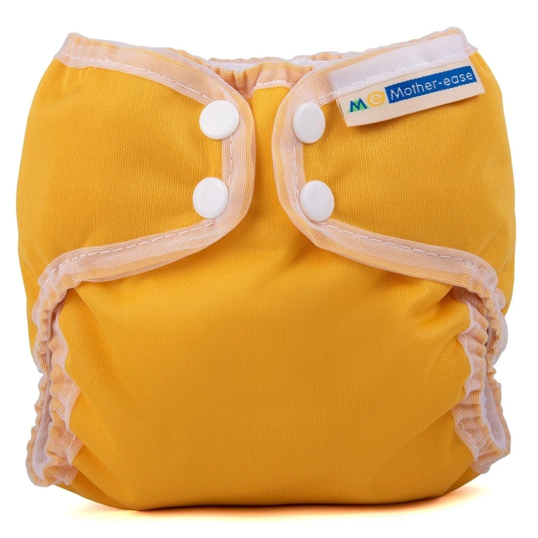 mother ease organic wizard uno all in one cloth diaper mustard yellow with white trim, logo on tag, newborn size