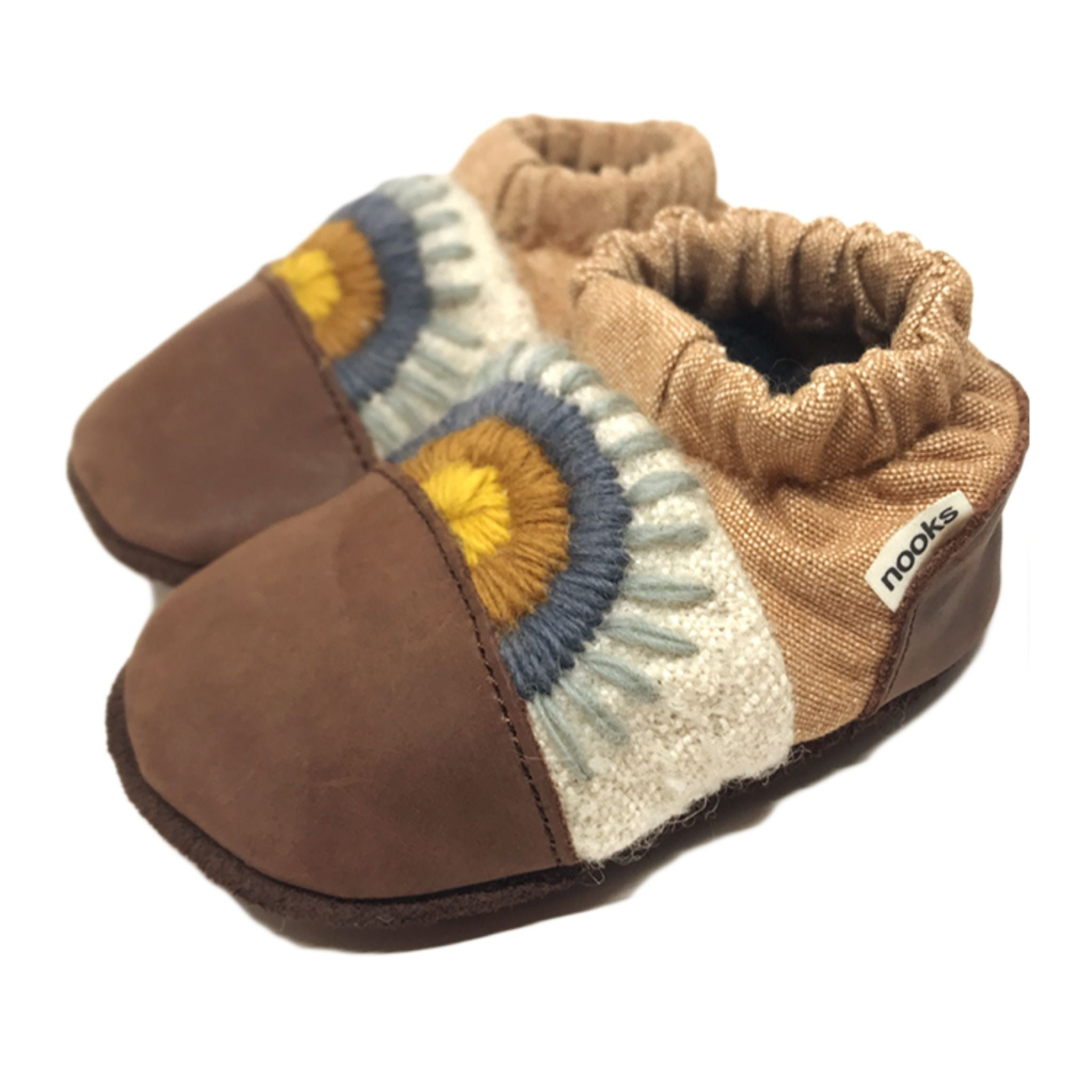 nooks design canvas and leather booties in baffin dark brown toe and heel; blue, orange, yellow rainbow design in middle and tan around ankle