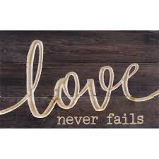 Love Never Fails Carved Calligraphy Sign
