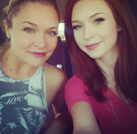 Blonde girl and Red head girl selfie sisters pink shirt