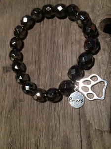 Berkleys Boutique - Crafted Jewelry, Hand Stamped, Black beaded bracelet with paw print charm