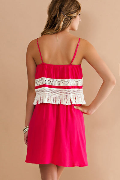 Solid rayon double layered slip dress featuring crochet fringe and lace detailing