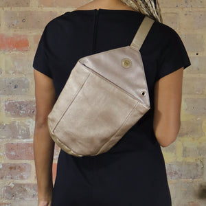 leather backpack, bronze