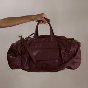 leather duffel, merlot