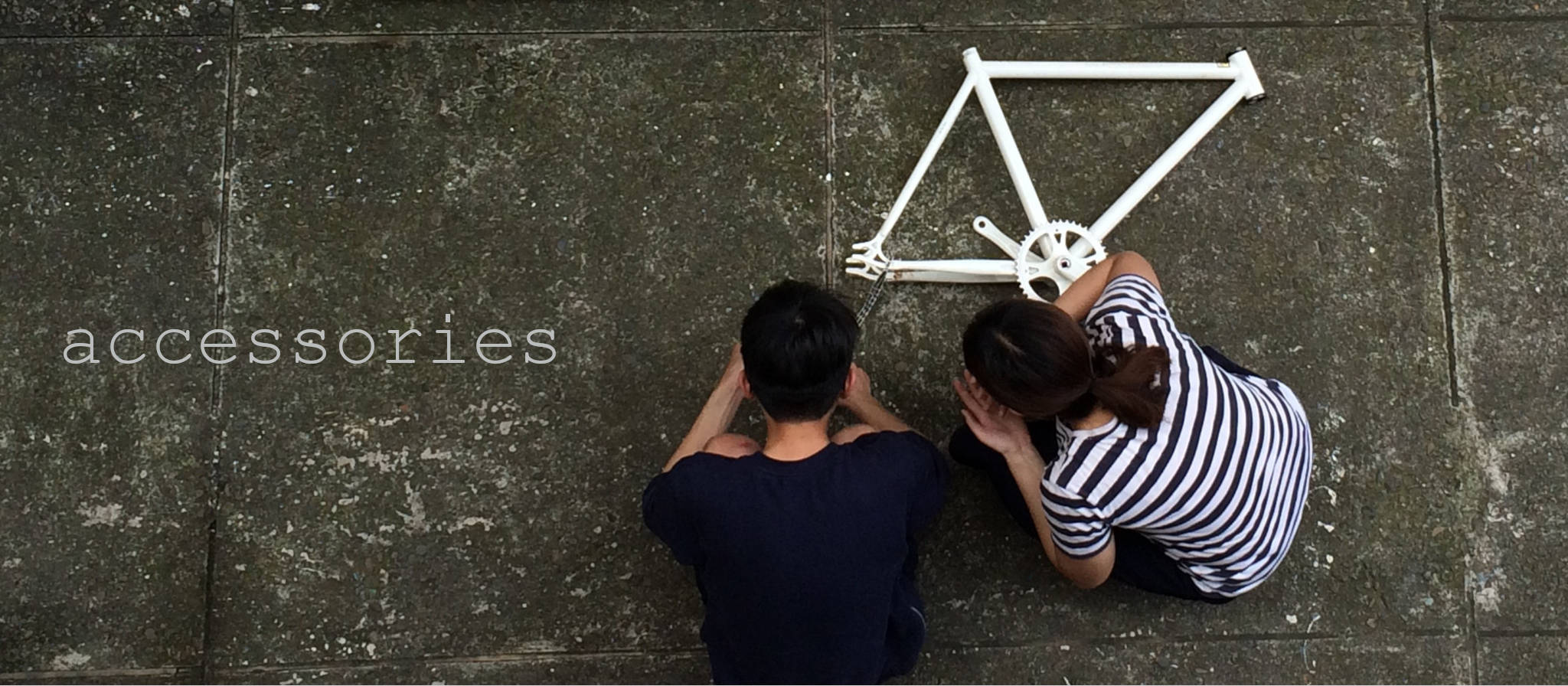 Upside Cyclestyle Accessories collection - man & woman with bicycle frame