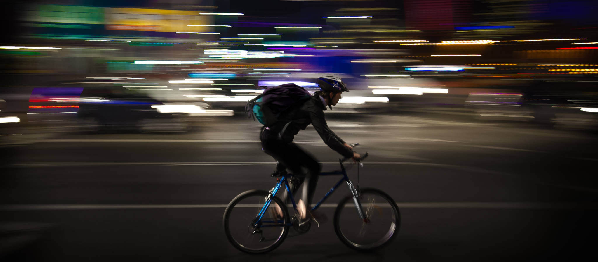 Upside Cyclestyle Last Chance Men's collection - city cyclist at night with lights