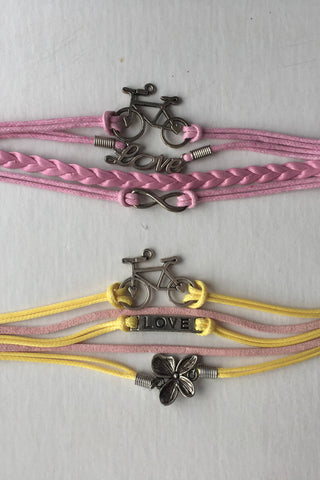 Upside Cyclestyle - Accessories - Silver-Plated Bicycle Love Bracelets in Pink & Yellow from Anice Jewellery