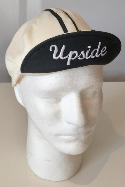 Upside Cyclestyle Cotton Cycling Cap in Off-White with silver reflective stripe - front view