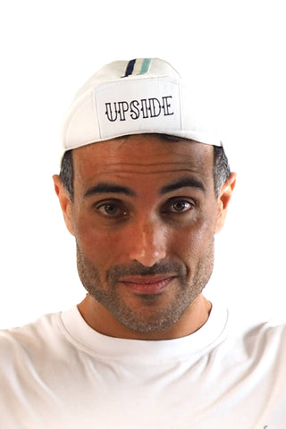 Upside Cyclestyle Cotton Cycling Cap in White with celeste & black stripe on model