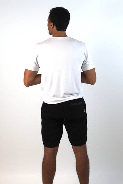 Upside Cyclestyle Men's Tapered Fleece Shorts in Black on model - back