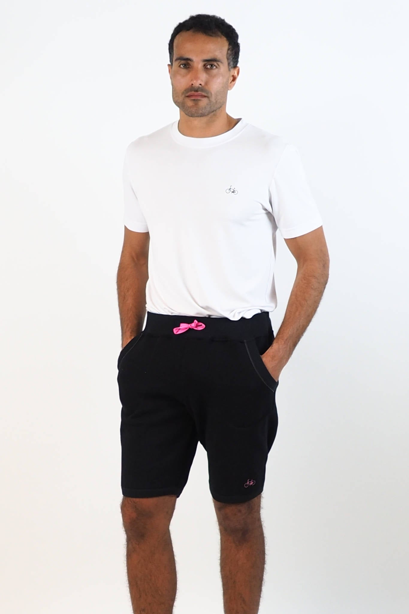 Upside Cyclestyle Men's Tapered Fleece Shorts in Black on model