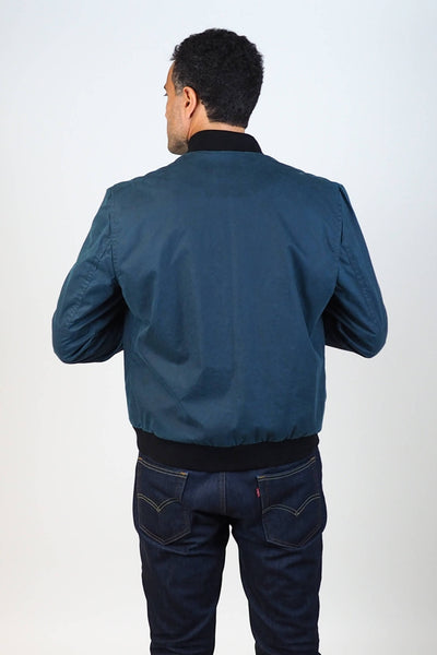 Upside Cyclestyle Men's Waxed Cotton Bomber Jacket in Teal on model - back