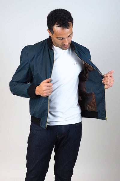 Upside Cyclestyle Men's Waxed Cotton Bomber Jacket in Teal zipped up on model showing lining