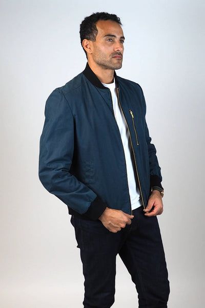 Upside Cyclestyle Men's Waxed Cotton Bomber Jacket in Teal unzipped on model