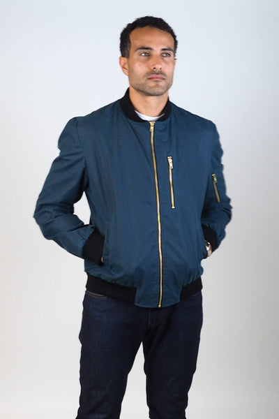 Upside Cyclestyle Men's Waxed Cotton Bomber Jacket in Teal zipped up on model