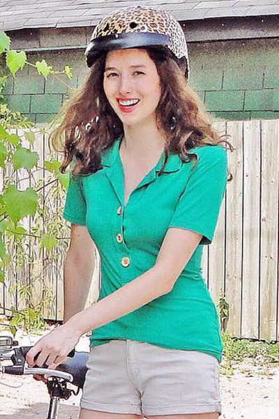 Upside Cyclestyle Women's Bamboo Polo Shirt in Kelly Green on model