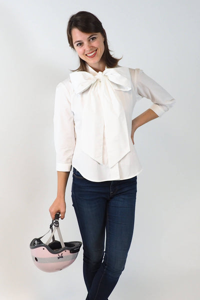 Upside Cyclestye Women's Bow Blouse in White on model with Sawako Pink Ribbon helmet