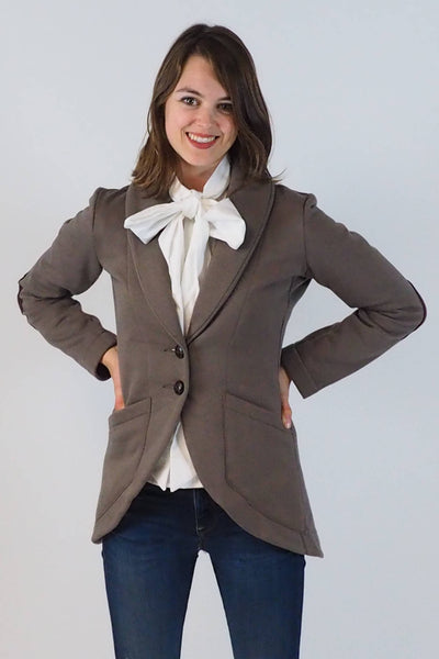 Upside Cyclestyle Women's Fleece Equestrian Jacket in Taupe with Bow Blouse on model