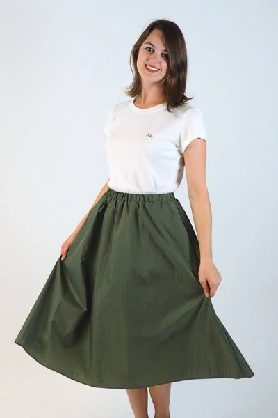 Upside Cyclestyle Women's Nylon Skirt with Snap in Olive on model billowing