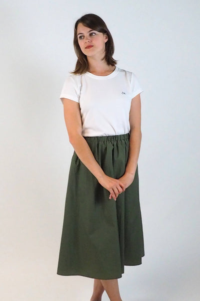 Upside Cyclestyle Women's Nylon Skirt with Snap in Olive on model