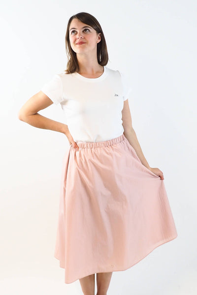 Upside Cyclestyle Women's Nylon Skirt with Snap in Pink on model