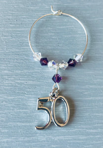 Handmade with Amethyst Swarovski Crystals and finished with a silver plated 50 charm - Amethyst is the birthstone colour for February - This wine glass charm is a lovely gift for her