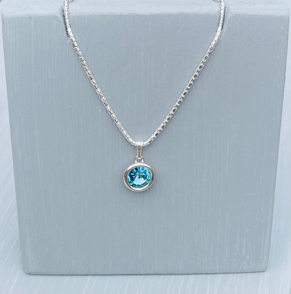 Set in a Sterling Silver Setting is an aquamarine Swarovski Crystal and finished with an 18inch 925 Sterling Silver Popcorn  Chain - Aquamarine is the birthstone for March - March birthday gift for Her - Mother's Day Gifts - Crystal is the chosen gift for 15th Wedding Anniversary Gifts