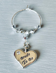 Lovely gift for a Bride To Be - this gorgeous Wine Glass Charm handmade with Sliver Plated Heart Charm engraved with Bride To Be and finished with Swarovski Crystals - this item is also free when purchasing Hen Party Wine Glass Charms