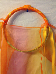 Fire Fabric Tabret with yellow and orange free flowing ribbon