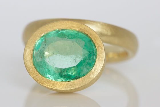Offset Oval Emerald Ring