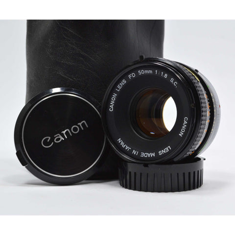 "Looks Good ""CANON FD"" CAMERA LENS 1:1.8 S.C Serial: 600705 in LEATHER CASE/POUCH"