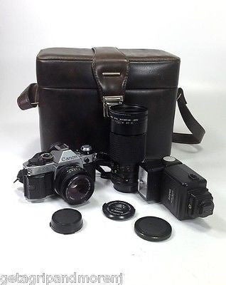 Canon AE-1 35mm Film Camera,30 DX Sunpak Flash & Tokina 35-200 Lense with Case