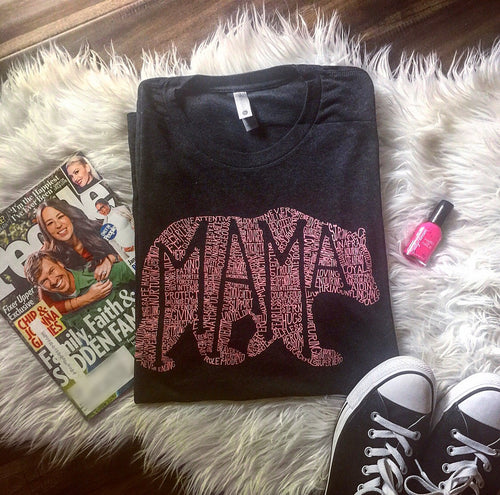 What's in a MAMA Unisex Tri-Blend Tee (Tri-Black + pink print)