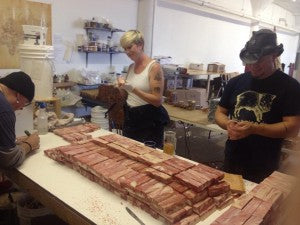 Here's Chuck, Erika, and Russ carving 1,055 bars of bacon soap