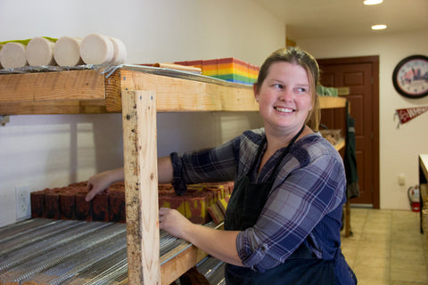 Katie racking handmade soap at Outlaw Soaps
