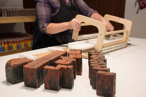 Katie cutting handmade soap in our workshop
