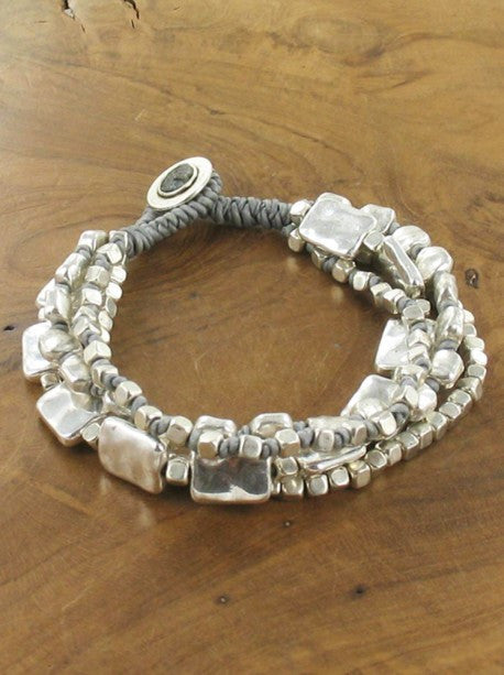 FOUR STRAND COTTON BRACELET WITH BEATEN METAL RG10/26