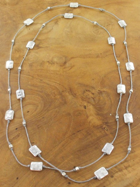 LONG NECKLACE WITH BEATEN RECTANGULAR CHARMS