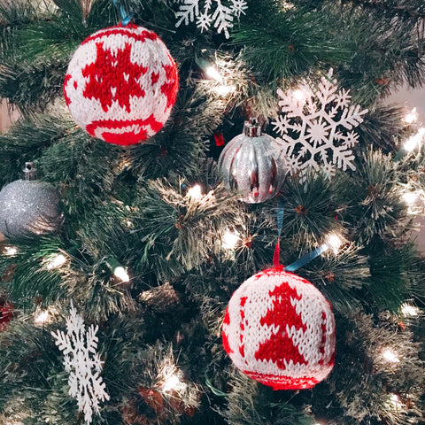 Knitted ornaments on tree