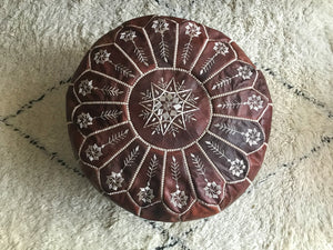 Moroccan pouf with embroidery in light brown oiled leather