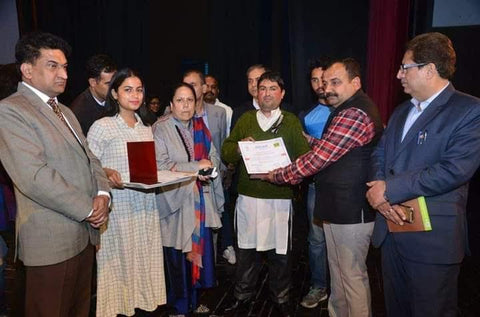 Fair Trade Artisan Tariq receiving an award by Kashmir State Govt Official