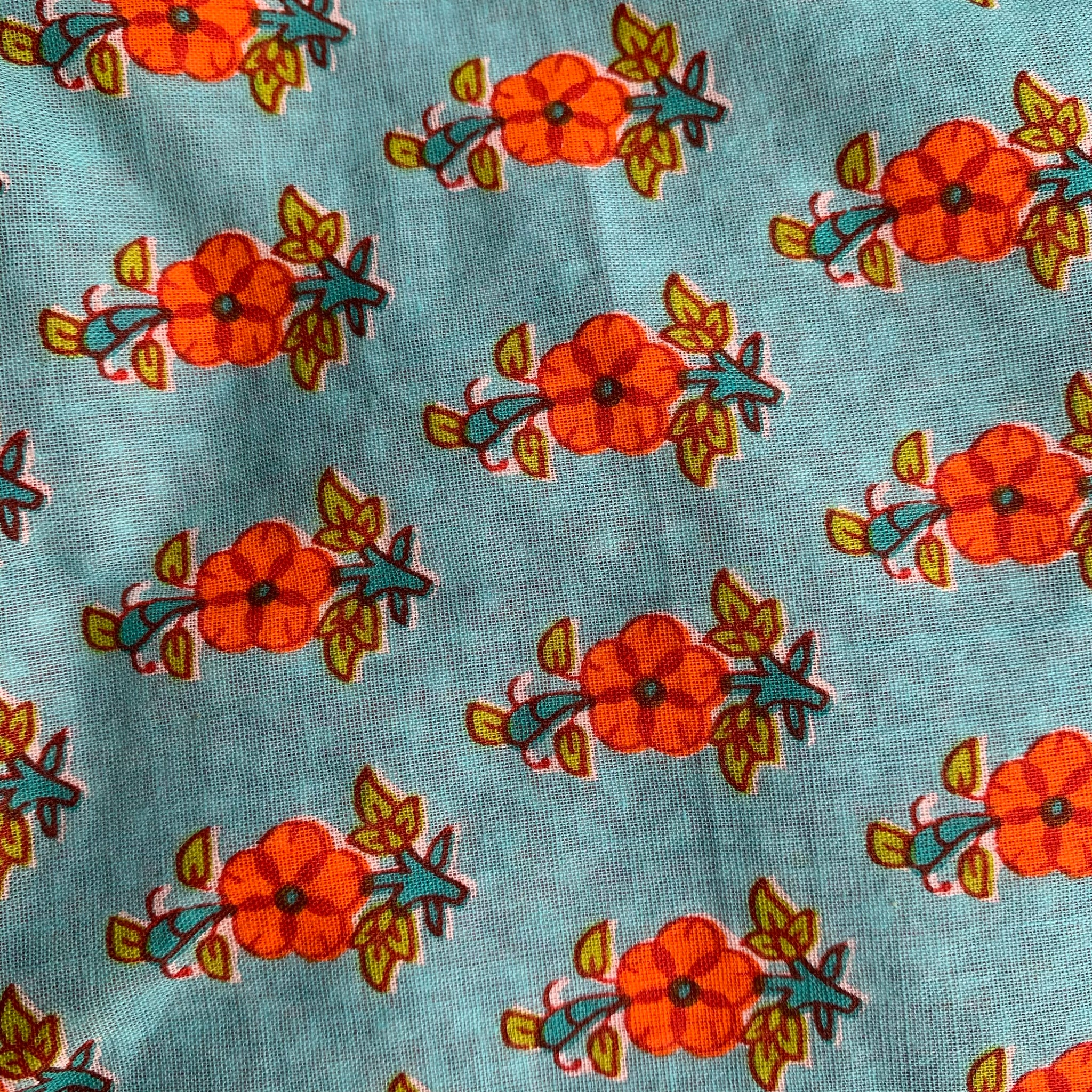 Fair Trade Ethical Reversible Child's Pinafore Turquoise Flower Design.