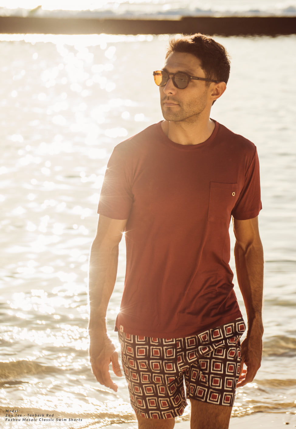 Tanbark Red Bamboo T-shirt with Fuzhou Mosaic classic swim shorts at sunset walking on the beach
