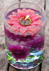 Ever wanted to make your own centrepiece?  Here's how to do it using artificial flowers and distilled water.