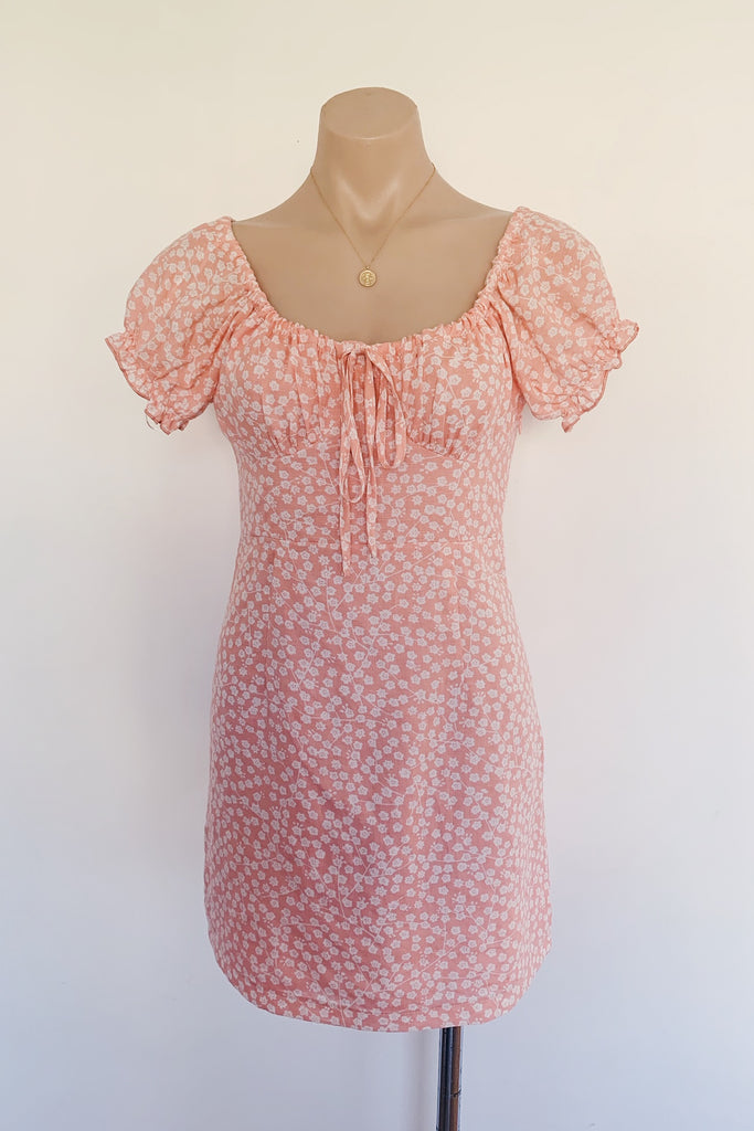 coral pink floral dress with capped sleeves