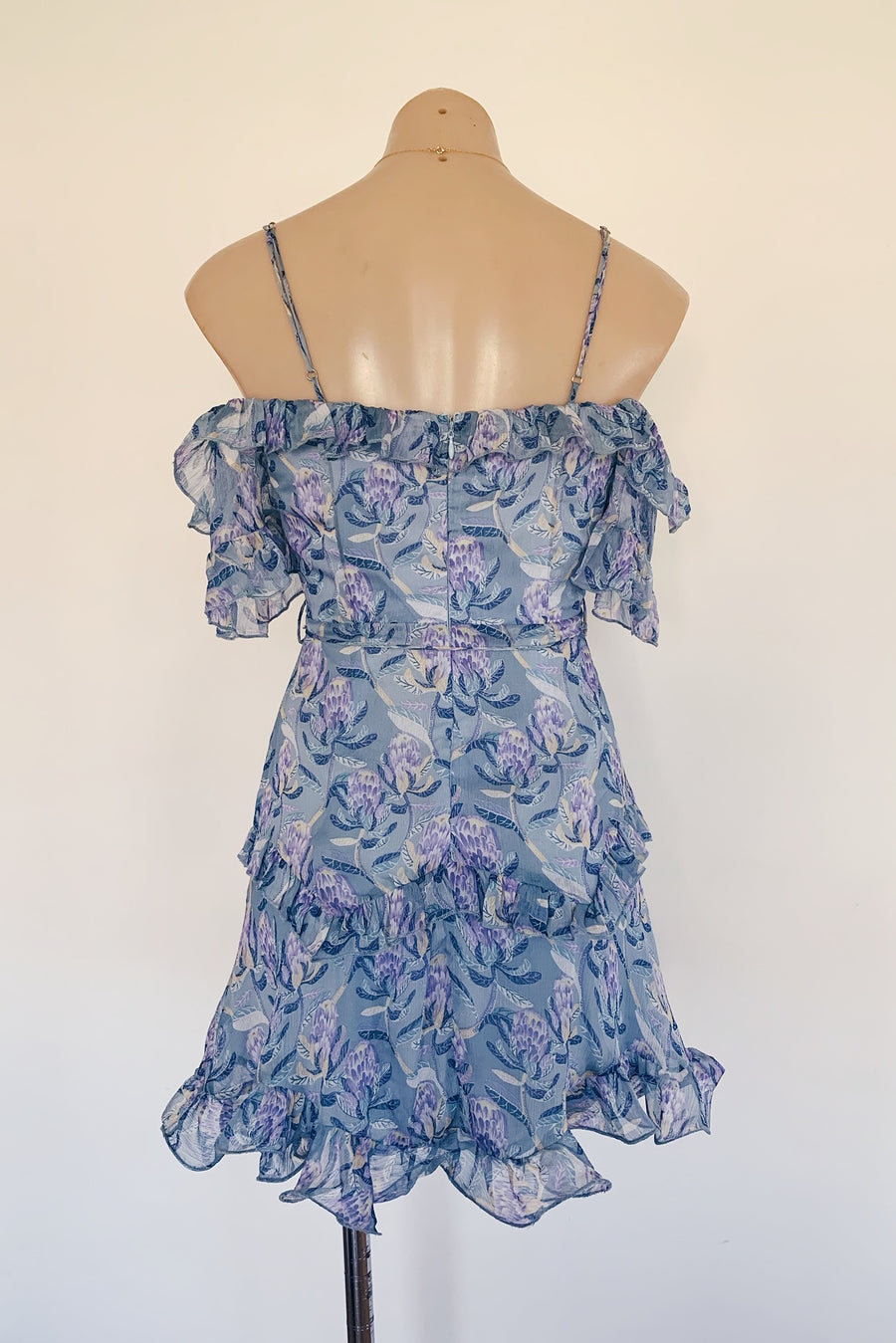 blue floral dress with ruffles and cut out shoulders