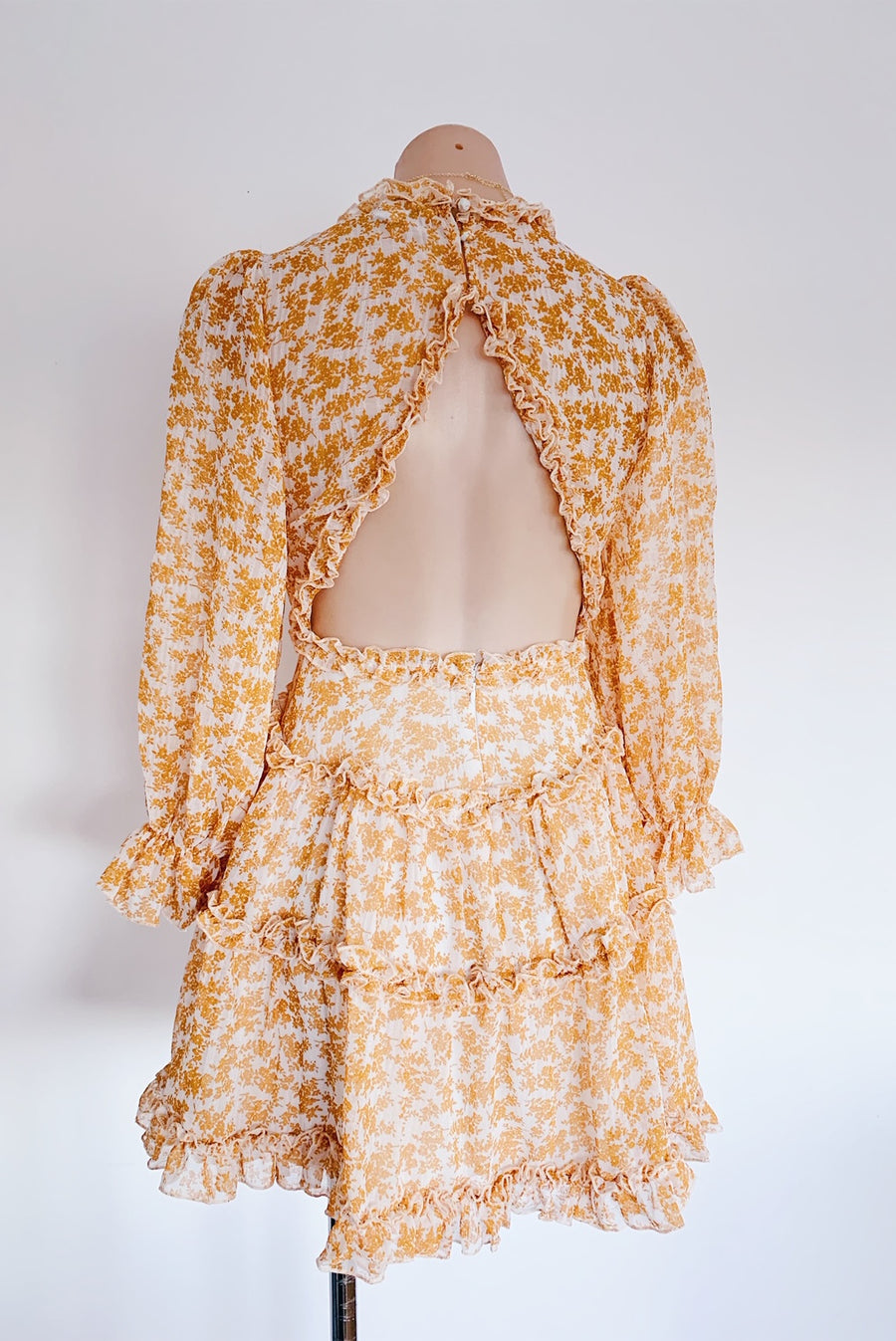 yellow floral dress with ruffle detailing and open back