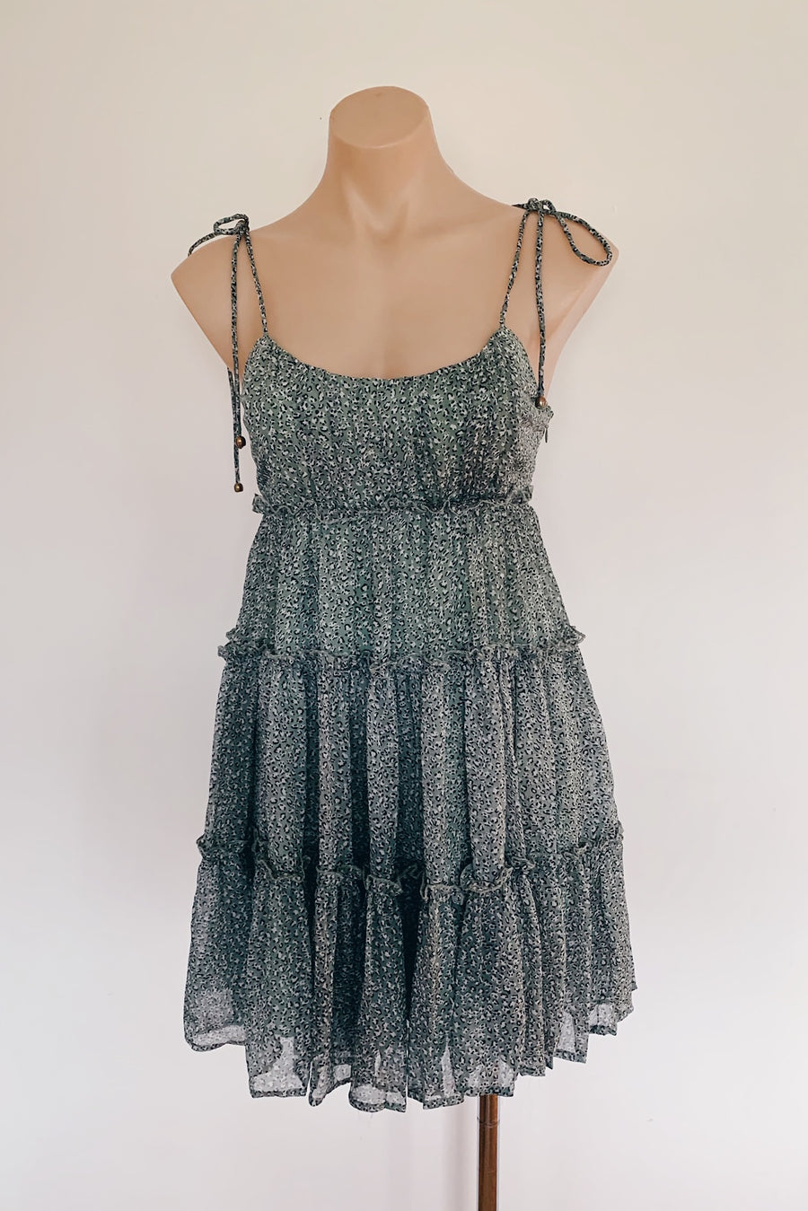 sage green dress with string tie up straps and ruffles