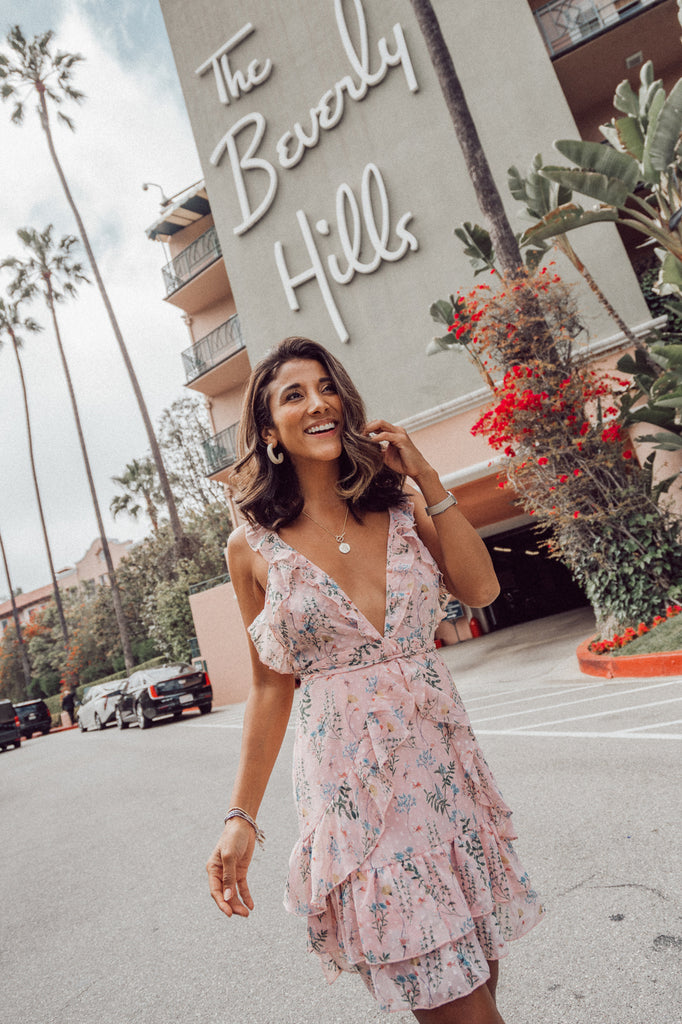 @maya_gypsy in Beverly Hills wearing HER Empire The Label pink floral Sweet Escape Dress
