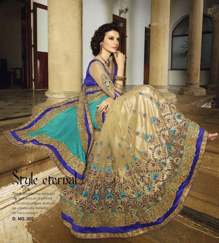 Bridal wear turquoise, blue and beige half and half net and crepe saree with net sleeves  blouse in work
